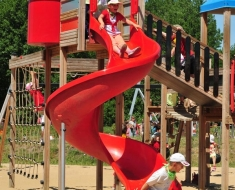 Red Twister Playground Slide in Action